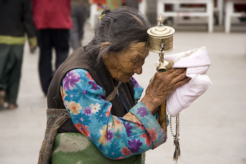 Elder Tibetan praying in Lhasa, Tibet